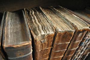 Old books awaiting restoration. Image by Tom Murphy VII. Image courtesy Wikimedia Commons.