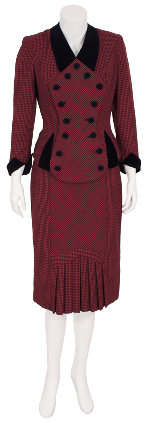 1940s red and black mini-check suit worn by Madonna in her portrayal of Eva Peron in the 1996 motion picture 'Evita.' Premiere Props image.