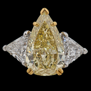 Highlighted in the sale is a beautifully made ring containing a platinum setting with a 22-karat yellow gold basket head that features one natural fancy yellow pear-shaped cut diamond. This diamond, approximately 5.05 carats, is flanked by two trillion-cut diamonds and is estimated to bring $50,000-$70,000. Image courtesy Cowan's Auctions Inc.
