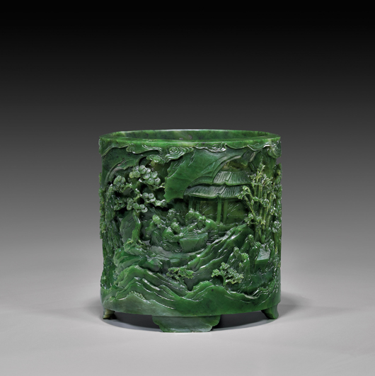 Chinese spinach jade brushpot decorated with landscape scene of scholars playing chess amid bamboo, pine and rockery, $73,200. I.M. Chait image.