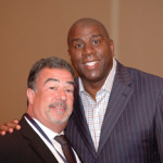 Earvin 'Magic' Johnson (right), at Grey Flannel Auctions' 2009 Basketball Hall of Fame pre-induction dinner with Grey Flannel's president, Richard E. Russek. Copyrighted image courtesy of the photographer, Chuck Miller.