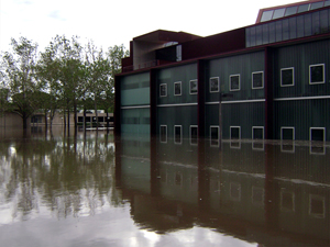 The University of Iowa's Art Building West (foreground) and Art Building (background) during the Iowa Flood of 2008. Image by Craig Dietrich. This file is licensed under the Creative Commons Attribution 3.0 Unported license.