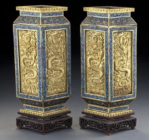 A pair of Chinese Qing Qianlong cloisonne vases depicting dragons and scrolling lotus, raised on original rosewood stands sold for $147,000. The estimate was $8,000-$12,000. Image courtesy Dallas Auction Gallery.