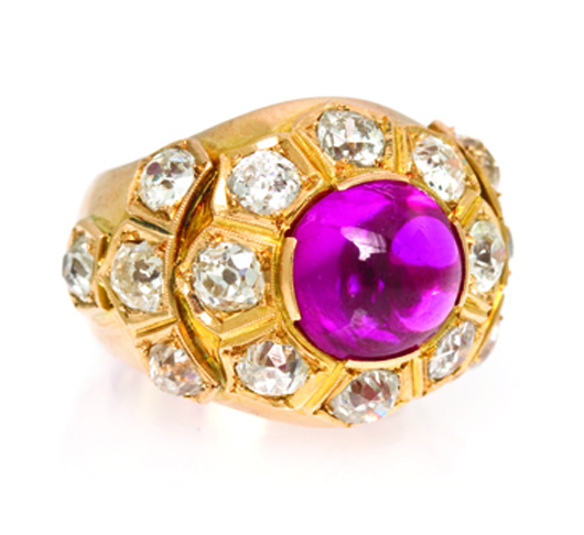 Important yellow gold, ruby and diamond ring containing one central oval cabochon cut ruby weighing approximately 6.20 carats surrounded by 16 old mine cut diamonds weighing approximately 4.40 carats. Price realized: $146,400. Image courtesy Leslie Hindman Auctioneers.