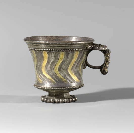 Sogdian parcel-gilt silver fluted cup, circa 700 A.D., width with handle 3 1/2 inches (8.9 cm); height 2 1/2 inches (6.3 cm). Courtesy J.J. Lally & Co.