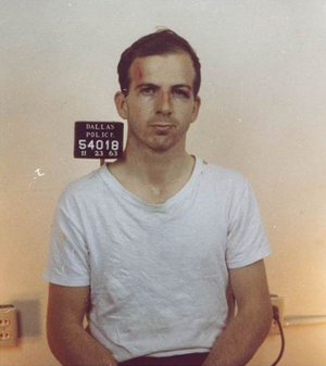 Lee Harvey Oswald's mugshot taken on Nov. 23, 1963, the day after he was arrested for the assassination of President John F. Kennedy in Dallas. Image courtesy Wikimedia Commons.
