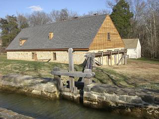 Reconstruction of George Washington's 1797 distillery near Mount Vernon, Virginia. This file is licensed under the Creative Commons Attribution-Share Alike 3.0 Unported license.