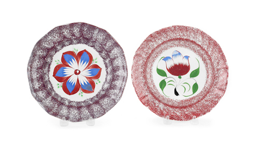 Spatter decoration was often used a border for bright freehand motifs. Perfect for display, two 8-inch plates – a purple-edged dahlia and a red-edged tulip – sold for $652 in January. Courtesy of Pook & Pook