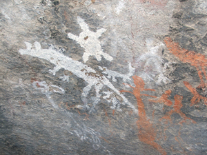 Aboriginal art in the 'Yankee Hat' shelter in Namadgi National Park, featuring a kangaroo, dingoes, echidna, turtles. Photo by Martyman of English language Wikipedia, licensed under the Creative Commons Attribution-Share Alike 3.0 Unported license.