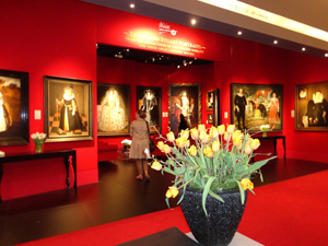 The TEFAF stand of London's Weiss gallery who sold the four important Tudor portraits on the back wall during the opening hour of the fair. The full-length portrait of Henry VIII on the right, known as The Ditchley Henry VIII, sold at an asking price of £2.5 million ($3.9m). Image Auction Central News.