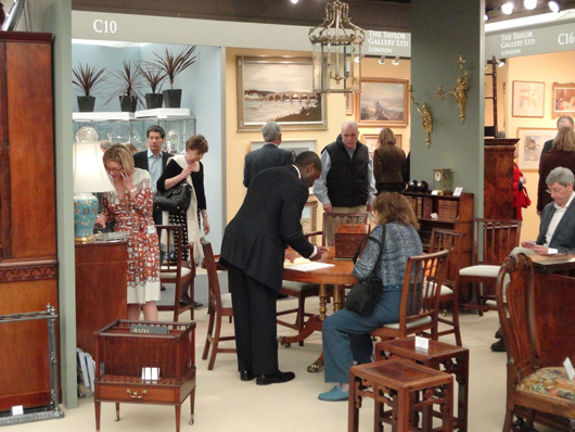 The stand of Edenbridge-based fine period furniture dealer Lennox Cato at the London BADA fair in March where Mr Cato was reporting