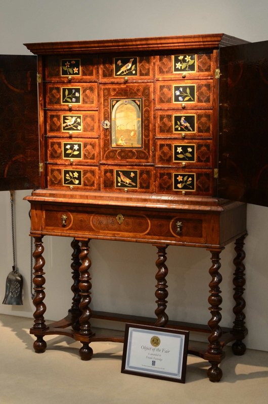 A rare late seventeenth-century English cabinet decorated with pieta dura panels on the stand of London furniture dealer Frank Partridge at the British Antique Dealers' Association Fair in Chelsea in March. Priced at £285,000 ($455,630), it was awarded the Gold Medal for 'Object of the Fair'. Image courtesy Frank Partridge and BADA Fair.