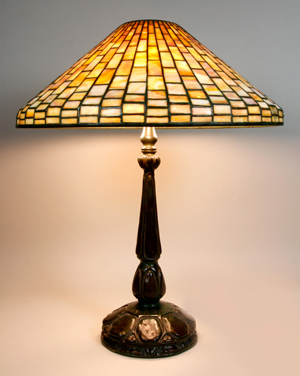 Louis Comfort Tiffany geometric table lamp, signed Tiffany Studios New York no. 1493 on shade, signed Tiffany Studios no. 587 on base, 25 inches high x 20 1/4 inches diameter. Sold for $14,000 Image courtesy Kaminski Auctions.