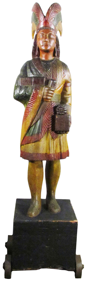 With its original paint intact, the 5-foot-tall Samuel Robb carved cigar store Indian achieved the auction's highest price, $94,400. Image courtesy Showtime Services.