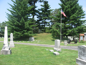 Southern side of the Odd Fellows' Cemetery Mound, located in Flagstone Cemetery (formerly the Odd Fellows' Cemetery) off Round Bottom Road in Newtown, Ohio. Built by the Adena culture of Native Americans, the mound is listed on the National Register of Historic Places. --