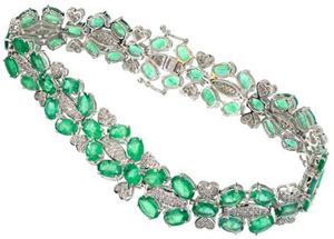 14K white gold bracelet featuring 19 carats of emeralds and 284 genuine round full diamonds with a total weight of 1 carat. Government Auction image.