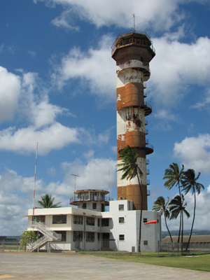 The air traffic control tower (which was, in fact, a water-filled submarine-escape training tower) at the former Naval Air Station, Ford Island, located within Pearl Harbor, Hawaii. Photo by LovesMacs, licensed under the Creative Commons Attribution-Share Alike 3.0 Unported license.