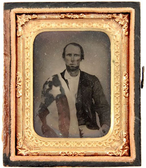 Civil War tinted tintype of man draped in the flag of the 18th Tennessee Infantry. Sold for $400 + buyer's premium in Affiliated Auctions' Dec. 5, 2009 sale. Image courtesy of LiveAuctioneers.com Archive and Affiliated Auctions.