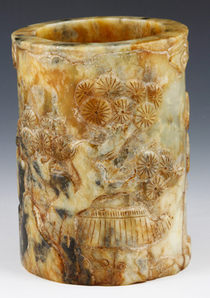 Brushpot, China, Qianlong Dynasty, stone carved with bamboo, plum blossoms and clouds, est. $4,000-$6,000. Kaminski's image.