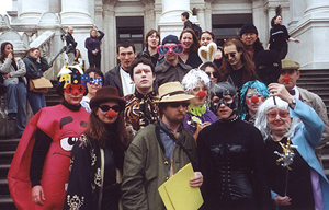 A movement known as the 'Stuckists' believes the Turner Prize should revert to its former status as an award for figurative painting. The first Stuckist demonstration against the Turner Prize was held at the Tate Britain, on Nov. 28, 2000. Protesters dressed as clowns to reflect their position that the Turner Prize is an 'ongoing national joke,' claiming 'the only artist who wouldn't be in danger of winning the Turner Prize is Turner.' Left to right: Red M & M costume: Ella Guru. Blue mask: Rachel Jordan. Brown hat/red nose: Elsa Dax. Brown shirt: Fanny. Straw hat: Philip Absolon. Silver tinsel: Katherine Gardner. Bunny ears: Michelle England. Cat woman: Charlotte Gavin. Dark glasses: Remy Noe. Blue tinsel: Susan Finlay. Black mask: Margaret Walsh. Flat cap: Matthew Robinson. http://www.stuckism.com/clown2000.html. Copyright Ella Guru, stuckism.com. http://www.stuckism.com/guru/index.html Released under GFDL, licensed under the Creative Commons Attribution-Share Alike 3.0 Unported license.