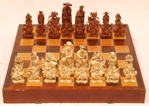 Rare antique Chinese hand-carved ivory chess set, fully relief carved throughout, Qianlong period (est. $7,000-$10,000). Image courtesy of Elite Decorative Arts.