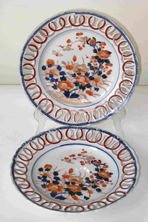 Fine and gorgeous pair of Chinese poly-glazed decorated reticulated plates. Image courtesy Gordon S. Converse & Co.