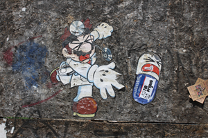 This Miyok wheatpasting is left over from earlier last winter. Still holding on, it's on Wythe Avenue in Wiliamsburg. 'Dr. Mario' by Miyok, Williamsburg. Photo by Kelsey Savage.