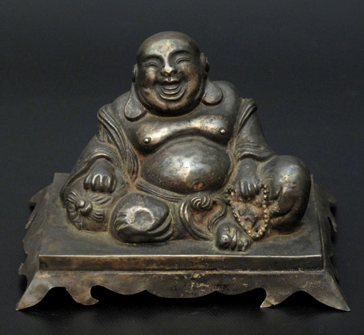 Chinese silver figure of Maitreya, future Buddha, with inscription, A.D. 186, 2.7 inches high x 4.1 inches wide. Estimate: $2,000-$3,000. Image courtesy Joyce Gallery Auction.