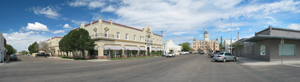 A panoramic view of downtown Marfa, Texas, population 1,981. At left is the Hotel Paisano. In the distance is Marfa's City Hall. Photo licensed under the Creative Commons Attribution-Share Alike 3.0 Unported license.