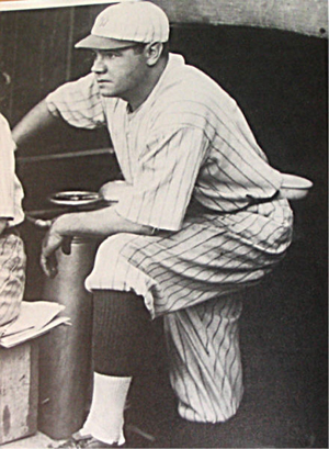 Babe Ruth in the dugout during his first season with the New York Yankees in 1920. Image courtesy Wikimedia Commons.
