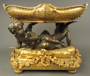 Dore and patinated bronze putti centerpiece, French, 19th century, est. $6,000-$8,000. Sterling Associates image.