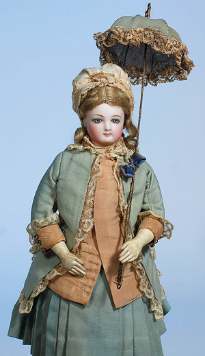 Jumeau French bisque poupee in original costume including parasol. Image courtesy Frasher's Doll Auctions.