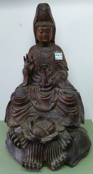 24-inch-tall Guanyin sculpture of Xinjiang walnut wood, likely from the Silk Road, Qing Dynasty, 1760-1840. Asian Antiques & Art Gallery image.