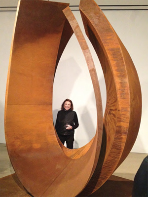 Beverly Pepper with a recent work of Cor-ten steel titled 'Curvae.' Image courtesy Frederik Meijer Gardens & Sculpture Park.