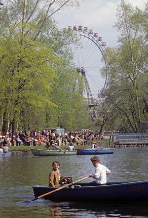 View of pond with Ferris wheel in background at Moscow's Gorky Central Park of Culture and Leisure, where Dasha Zhukova plans to install a 'paper tube' venue. Image by Valeriy Shustov, provided to Wikimedia Commons by Russian International News Agency (RIA Novosti) and licensed under the Creative Commons Attribution-Share Alike 3.0 Unported license.