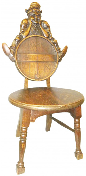 The carved man leaning on the back of this wooden chair must have bumped into the head of a person seated on it. But in spite of the discomfort, the unique humorous design attracted a buyer who paid $885 for the chair at a Showtime auction in Ann Arbor, Mich.