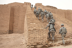 U.S. soldiers climb the reconstructed stairs of the Ziggurat of Ur in Iraq in 2010. The ancient Mesopotamian temple tower was damaged in the First Gulf War in 1991 by small arms fire and the structure was shaken by explosions.Image courtesy Wikimedia Commons.