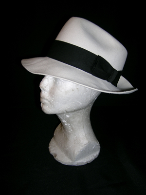 Michael Jackson's fedora from the 1987 music video 'Smooth Criminal.' It has Jackson's name, printed in gold, on the inside brim. Image courtesy Premiere Props.