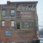 Coca-Cola outdoor mural, or 'ghost sign,' painted by an early 'walldog' in the first quarter of the 20th century in Schenectady, N.Y. Photo copyright Chuck Miller. All rights reserved.