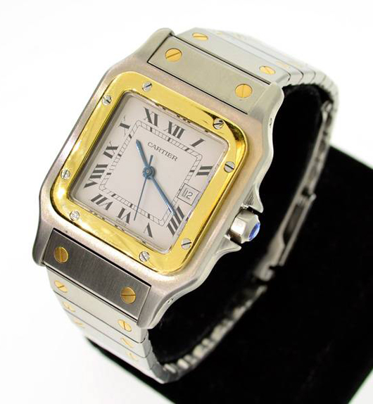 Cartier women's stainless steel and gold watch. Government Auction image.