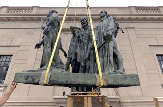 Rodin's 'The Burghers of Calais,' is hoisted into place. Modeled 1884-95; cast 1919-21. Cast by the founder Alexis Rudier, Paris, 1874-1952. Bronze, 82 1/2 x 94 x 75 inches (209.6 x 238.8 x 190.5 cm). Rodin Museum, bequest of Jules E. Mastbaum, 1929. Photograph courtesy Philadelphia Museum of Art.