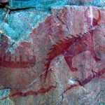 An example of a Native American pictograph, this panel with images of a canoe, Michipeshu (top right) and two serpents (below) is located at Agawa Rock, Lake Superior Provincial Park, Ontario, Canada. Photo taken July 26, 2011 by D. Gordon E. Robertson, licensed under the Creative Commons Attribution-Share Alike 3.0 Unported license.