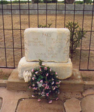 Outlaw Billy the Kid's tombstone was pushed off its base. Image courtesy Wikimedia Commons.