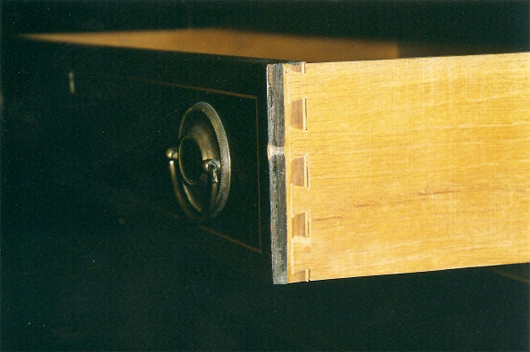 This is a modern, 20th century machine-made dovetail drawer joint. Photo by Fred Taylor.