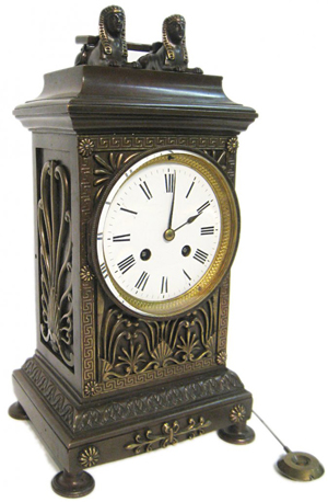 This gorgeous Sphinx shape mantel clock, 14 1/2 inches tall, should realize $1,500-$3,000. Gordon S. Converse & Co. image.