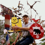 North Carolina folk artist Vollis Simpson with some of his whirligigs. Image by Burk Uzzle.