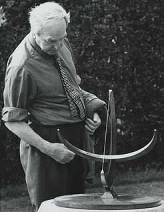 Henry Moore with working model for 'Sundial.' Circa-1969 photo from The Henry Moore Foundation archive.