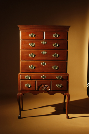 Queen Anne walnut high chest of drawers featuring a fan carved drawer, scrolled apron and tall cabriole legs. Coastal Massachusetts, likely Boston or Salem, 1770-1795. Courtesy Nathan Liverant & Son.