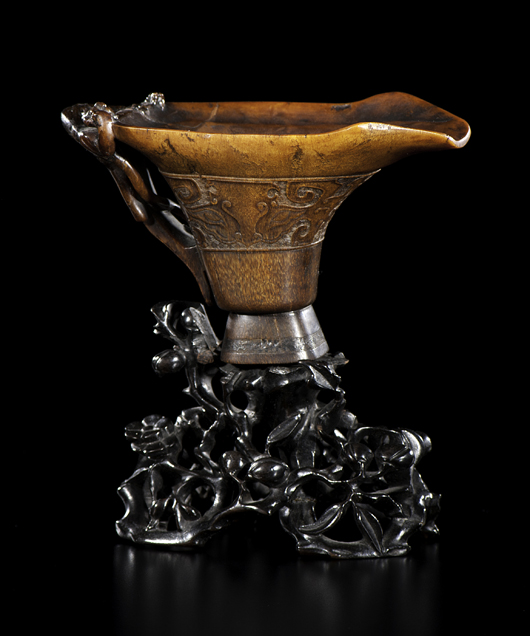 Chinese, a libation cup of rhinoceros horn, atop a carved and reticulated flowering stand. Relief carving along sides, chilong handle and squared away pouring spout. Estimate: $100,000-$150,000. Cowan's Auctions Inc. image.
