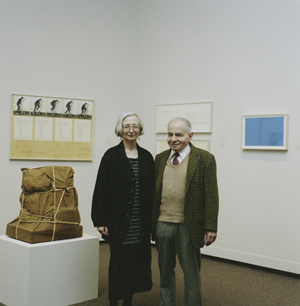 Dorothy and Herbert Vogel in the 1994 exhibition 'From Minimal to Conceptual Art: Works from the Dorothy and Herbert Vogel Collection at the National Gallery of Art.' Photo by John Tsantes. National Gallery of Art, Washington, D.C., Gallery Archives.